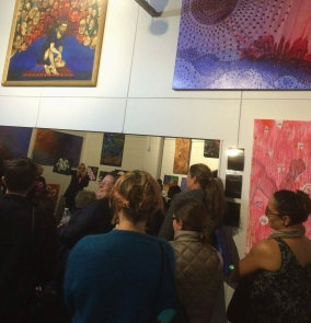 An excited gathering of Sisters Inside Inc members, family, friends and gallery-goers